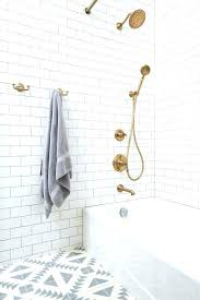 gold bath faucet brushed gold bathroom faucet renovated bathroom with white subway tile white and grey