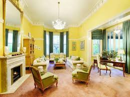 Yellow Chairs For Living Room Living Room Yellow Living Room With Two Sofa And Single Table