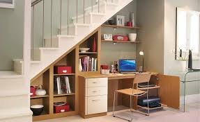 home office solution. A Desk With Shelving Under The Stairs In This Home Is An Ideal Office Solution