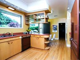 cool mid century modern kitchen design with laminate wood flooring and modern kitchen cabinets plus recessed lighting