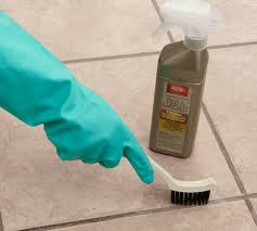 clean the entire floor as you normally would and remove any loose dirt and dust if your grout has an old worn coating of grout sealer that still causes