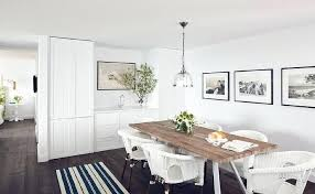 salvaged wood dining table with white wicker chairs barn round