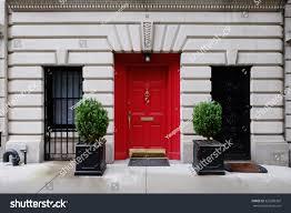 city apartment building entrance. beautiful building. entrance red door, manhattan new york, usa. classic apartment estate city building a