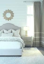 white shiplap headboard wood headboard a wooden sunburst mirror lined a white wall placed over a white shiplap headboard