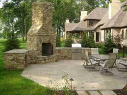 outdoor patio fireplace with outdoor kitchen