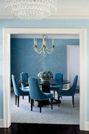 expandable round table dining room traditional with blue velvet chairs blue wall paper chandelier