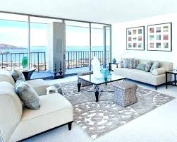area rug over carpet decorating carpet in living room area rug over carpet in bedroom example of a large trendy living