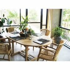 chic teak furniture. teak round elzas extension table made by chic furniture