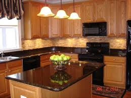 kitchen wood furniture. Oak Wood Cabinets With Under Cabinet Lighting And Pendant Plus Black Granite Countertop For Traditional Kitchen Design Furniture A