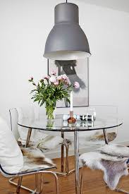 check out this clear and chic dining room space featuring the transpa tobias chairs from ikea