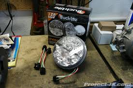 truck lite jeep jk wrangler led headlight installation write up 1 pop open your hood and then using a 10mm wrench disconnect the negative battery lead