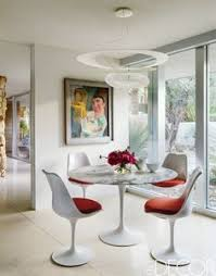 a sleek and modern dining room in a gorgeous palm springs home