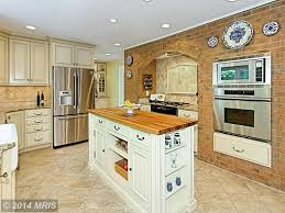 Travertine Floors In Kitchen Country Kitchen With Raised Panel Stone Tile In Clifton Va