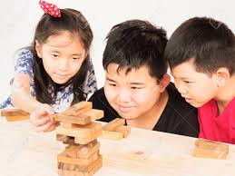 Game Played With Wooden Blocks Children Is Playing A Wood Blocks Tower Game For Practicing Their 85