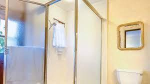 how to adjust a glass shower door