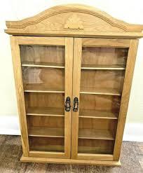 vintage wooden curio cabinet display