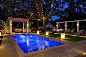 beautiful outdoor lighting. Homey Outdoor Lighting Around Pool Peek Into This Resort Style Backyard HGTV S Decorating Design Beautiful