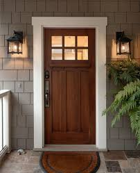 styles of lighting. craftsman exterior door a couple of classic lighting fixtures gray subway tiles walls decorative front styles b
