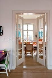 dining room doors. view through double doors to dining room in odense i