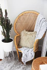 pillow chair. wooden woven accent chair and potted cactus // love the mix of textures here from pillow