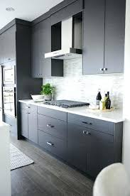 gray kitchen cabinets modern gray kitchen features dark gray flat front cabinets paired with white quartz and a grey kitchen cupboards