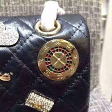 chanel outlet. chanel-255-embellished-with-casino-badges-black-25cm- chanel outlet