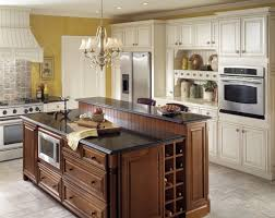 enchanting kraftmaid kitchen island with seating beside end cabinet wine  rack under metal and crystal chandeliers