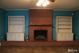 painted brick fireplace with revealed brick stone fireplace on blue wall paint between double