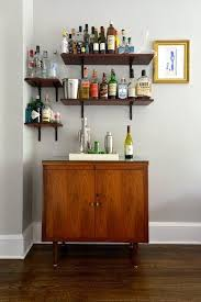 Creative At-Home Bars- Corner bar area with wood cabinet ans shelving.