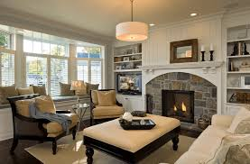 Transitional living room with stone fireplace insert