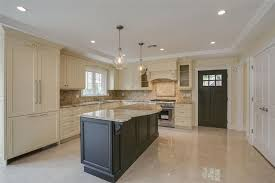 cream kitchen cabinets with black countertops. Traditional Kitchen With Cream Recessed Panel Cabinets And Dark Wood Island Calacatta Gold Marble Black Countertops