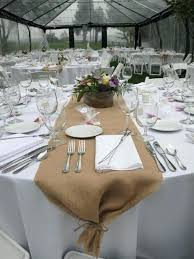 stock up table with white tablecloth and wedding covering burlap wooden boxes runner plastic tablecloths