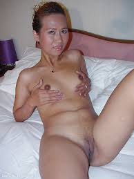 Skinny thai babe with tiny tits posing and spreading her legs.
