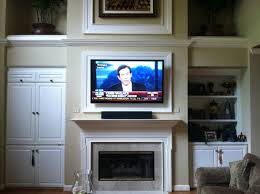 tv installation over fireplace photos