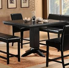 full black tall kitchen table with black leather chairs and bench