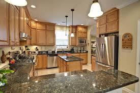 granite countertops green maple cabinets fort wayne indiana northern michigan mkd kitchens