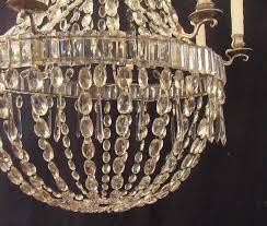 a late 18th century english regency basket crystal chandelier with eight sheffield silver arms circa