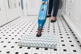 a close up of our pick with easy switch pads cleaning a tiled floor