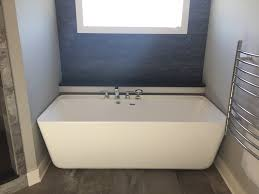 71 freestanding bathtub with faucets mounted to the bathtub