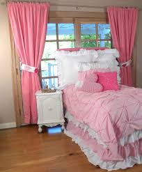 pink and white ruffle comforter with pink curtains and wooden floor for bedroom decoration ideas