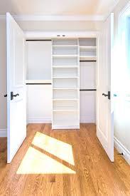 empty walk in closet. Big Walk In Closet Wood Floor Shelves Doors Window Traditional Bedroom Empty .