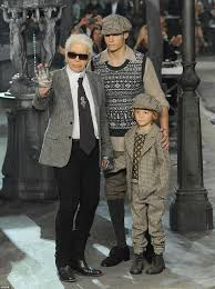 paying homage to paris lagerfeld wearing a herringbone jacket silver gloves and his