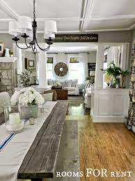 formal dining rooms with columns. the farmhouse feel continues in dining room. we made planked table and bench, to keep things relaxed less formal feeling, rooms with columns