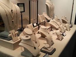 various jewelry displays with pieces on them