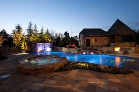 swimming pool lighting options. Nicely_lit_pool_and_surroundings. Keeping Your Swimming Pool Lighting Options O