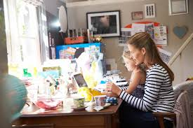 running home office. Mother Running Small Business From Home Office, With Daughter Office
