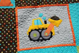 Birthday Party Quilts | Trends and Traditions & I quilted the background to look like rocks or pebbles. I love that little  construction cone in the ... Adamdwight.com