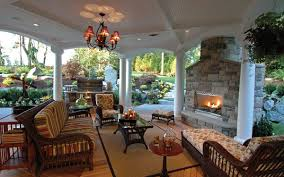 stunning covered outdoor living area with fireplace view this house plan