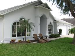 painting a merritt island homes exterior stucco walls and doors before and after you