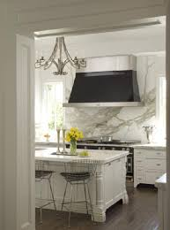 we go with a white marble countertop in the kitchen that i discussed here is also using the same material as a backsplash solid slabs to showcase the